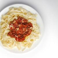 Spaghetti bolognese with parmesan cheese photo