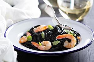 Squid ink homemade pasta with shrimp photo