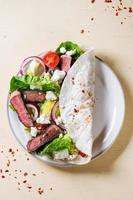 Taco with feta cheese and beef photo