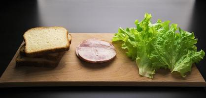 sandwich with tomato cheese and ham photo