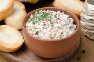 pate of smoked fish with sour cream and herbs, close-up