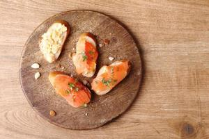 Scrambled eggs with smoked salmon, on baguette toast photo