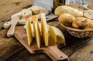 Delicious ripe cheese with crispy baguette and wine photo