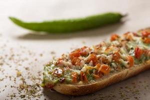 Baguette with pesto photo