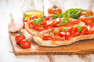 Italian starter, bruschetta with Sicilian red fresh tomato on a