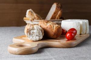 Sliced bread on wood photo