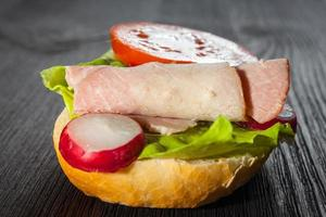 Ham, salad submarine sandwich from freshly cut baguette