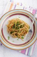 spaghetti with red pesto and parsley