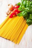 spaghetti ingredients on a white wooden table photo