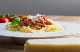 Spaghetti with Bolognese Sauce Parmesan and basil photo