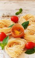 raw egg and noodles with spices photo