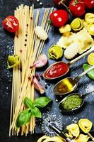 Tomato sauce, olive oil, pesto and pasta photo