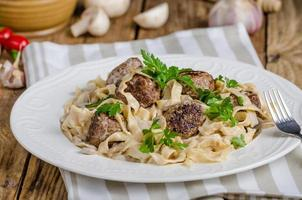 Homemade tagliatelle with meat balls photo