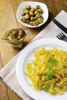 Delicious pasta with pesto on plate on table close-up photo