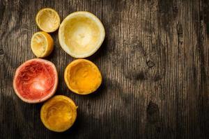 Squeezed citrus fruit, top view photo