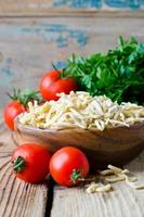 Raw, homemade pasta and vegetables photo