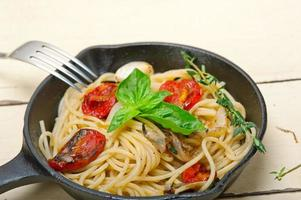 spaghetti pasta with baked cherry tomatoes and basil