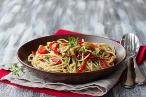 Pasta with baked pepper, garlic, herb oil and pine nuts