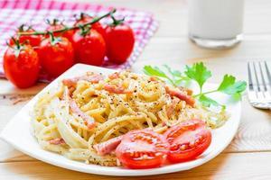 Pasta carbonara on the white plate closeup