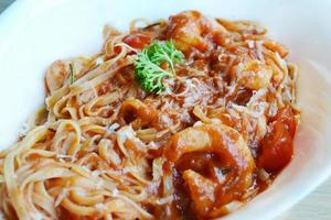 Delicious tomato pasta spaghetti with shrimps and other seafood