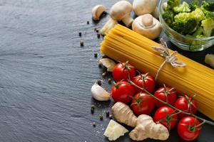 Pasta ingredients - spaghetti, cherry tomatoe, broccoli, mushrooms