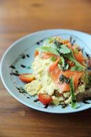 Scrambled eggs with smoked salmon and avocado