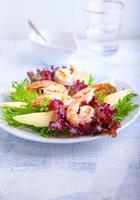 Avocado shrimp salad with mustard sauce photo