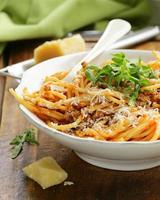 traditional pasta with tomato sauce spaghetti bolognese with parmesan photo