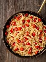 rustic spicy italian crab and cherry tomato spaghetti pasta photo