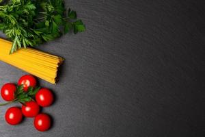 Raw pasta with tomatoes and parsley