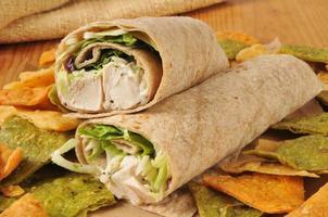 Chicken wrap sandwich on veggie tortilla chips photo