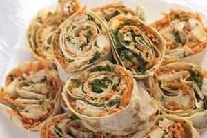 Rolls with carrots, chicken and greens