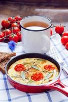 Omelette with cherry tomatoes photo