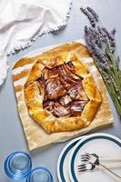 Healthy open apple pie with lavender. French cuisine on grey