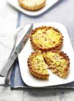 two quiches with bacon on a plate