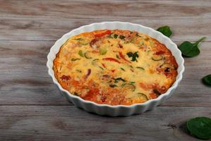 Freshly Baked Crustless Quiche with Vegetables. Family Meal.