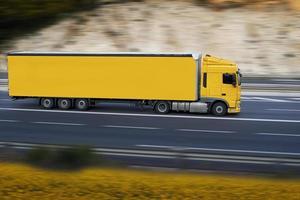 yellow semi truck photo