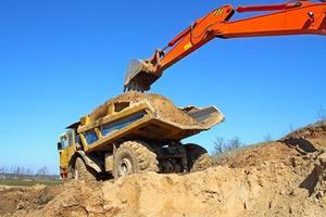 Backhoe loader loading dumper photo