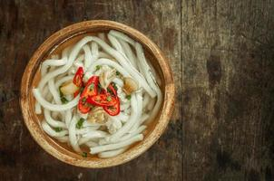 udon noodle in wood bowl on wooden floor background