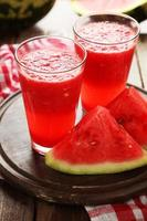 Watermelon smoothies on brown wooden background