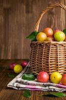 Plums in a wicker basket.
