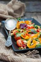 salad with marinated pumpkin, lettuce and cherry tomatoes photo