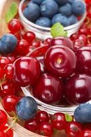 bowl of cherries and assorted fresh berries, close-up