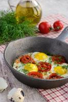 Breakfast with fried quail eggs with cherry tomatoes