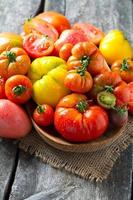 assorted tomatoes on wooden surface