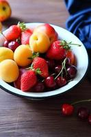 summer fruits in rustic bowl