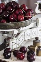 Ripe cherry on vintage scales