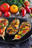 Stuffed eggplant with fried vegetables photo