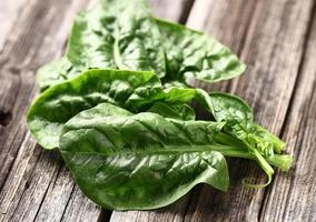 Spinach on a wooden background photo