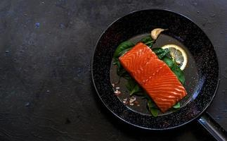 Salmon fillet in pan photo
